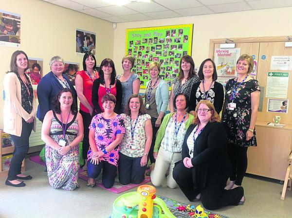 This Is Wiltshire: Staff at Butterflies Children's Centre in Swindon which could face closure under plans by Swindon Council