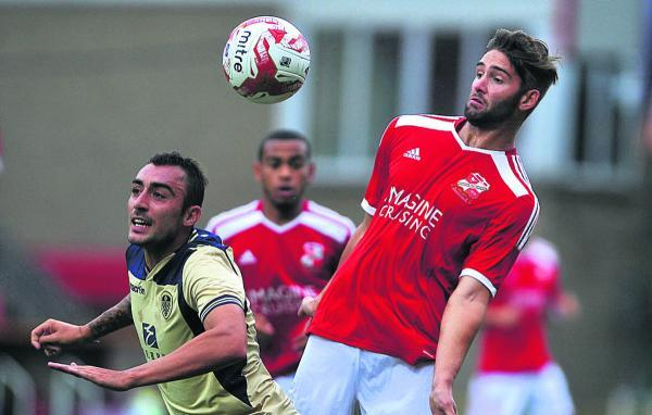 This Is Wiltshire: Wiltshire's Jordan Turnbull (right) featured for Swindon Town against Leeds United on Tuesday