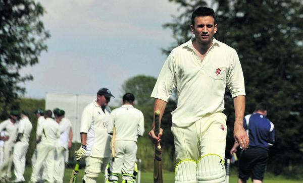 This Is Wiltshire: Avebury's Richard Hughes walks after being dismissed against Beehive, below Beehive's Ben Clift turns his arm over