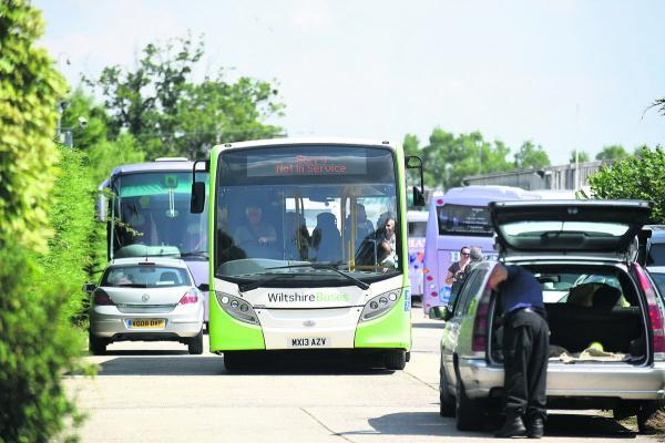 This Is Wiltshire: Axed Hatts Travel staff are bussed away from firm's Foxham headquarters last Friday. Picture by Diane Vose