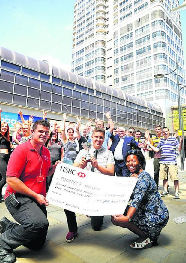 This Is Wiltshire: Grant Hesketh, InSwindon street team member, James Gilford of McDonalds and Gifty Tawiah of Prospect Hospice with fundraisers and well-wishers