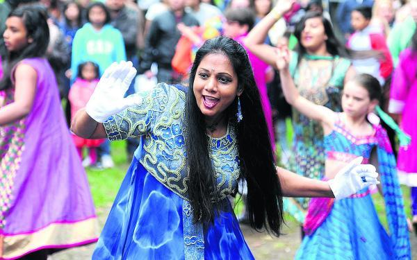 This Is Wiltshire: Colourful action from last year's Mela Dhamaka. The September event has been postponed
