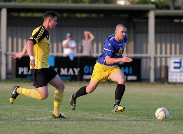 This Is Wiltshire: Goalscorer Lee Phillips gets on the ball during Chippenham Town's friendly against former Bluebirds boss Darren Perrin's Melksham Town at Hardenhuish Park on Thursday night (Picture: Chippenham Town FC)