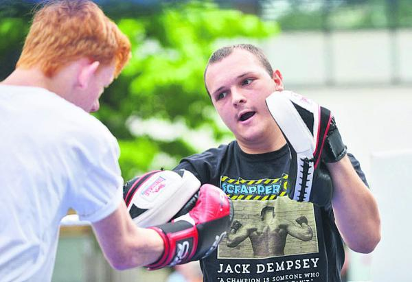 This Is Wiltshire: Boxing with Scrappers Gym at Wharf Green. Charlie Dawson shows  Liam Brewster the ropes