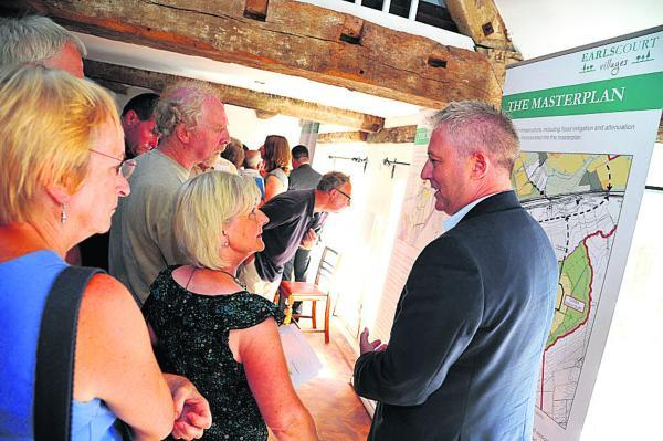This Is Wiltshire: Residents study the plan at a consultation held last month