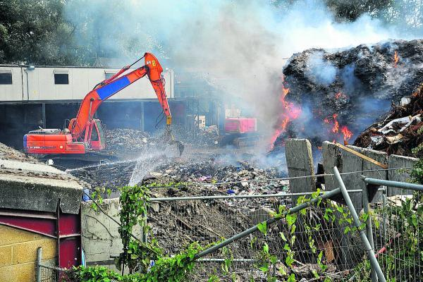 This Is Wiltshire: Recycling firm frustrated as blaze still burns