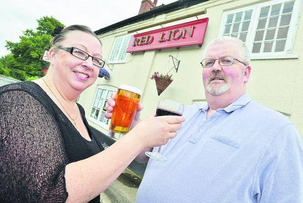This Is Wiltshire: Cheers! Julie Wyatt and Mark Farrell  propose a toast to the future of the Red Lion