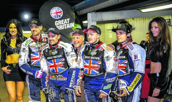 This Is Wiltshire: Robins' boss Alun Rossiter celebrates with his Great Britain team after they secured their place in the World Cup final last weekend