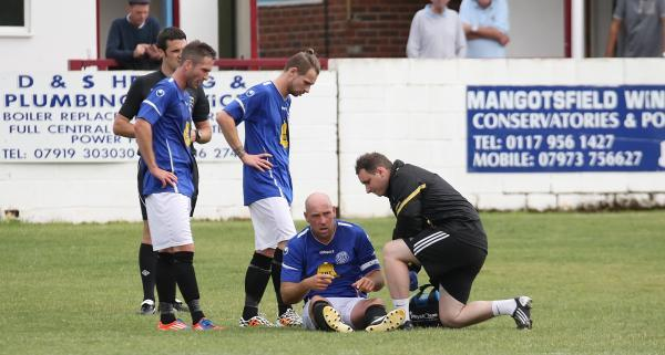 This Is Wiltshire: Striker Alan Griffin is treated for a thigh injury that forced him off in today's friendly (Picture by Robin Foster)