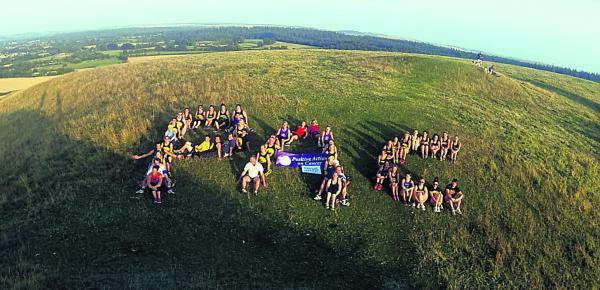 This Is Wiltshire: Fundraisers on Cley Hill after completing their gruelling 5km challenge for Frome charity Positive Action on Cancer