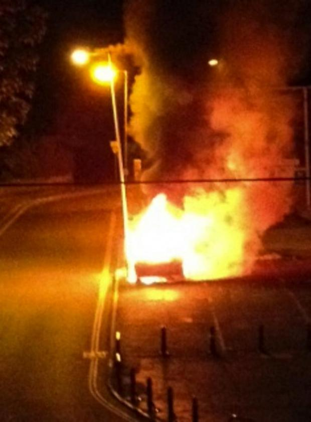 This Is Wiltshire: The car alight at Skurrays in George Lane, Marlborough