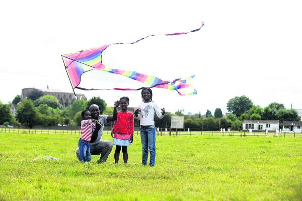 This Is Wiltshire: Nimdeah, left, dad Kutin, Odeshye and Nteasie Amankwa at Malmesbury Kite Festival. Picture by Diane Vose