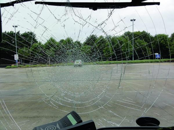 This Is Wiltshire: The bus windscreen smashed by someone throwing a 'missile' from a footbridge over Tewkesbury Way