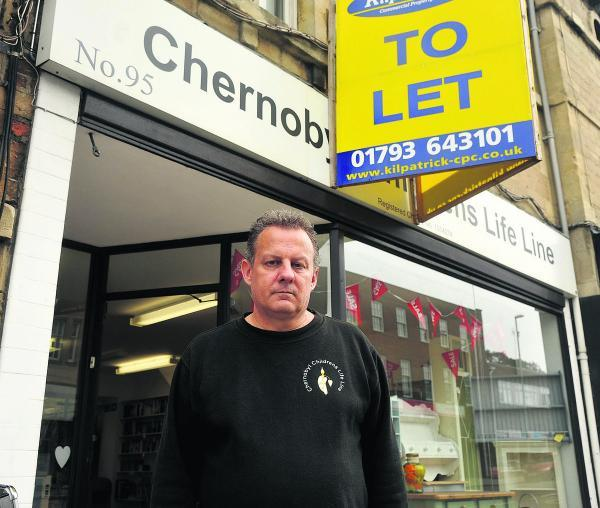 This Is Wiltshire: Volunteer David Simonds at the Chernobyl Charity Shop in Old Town,which is closing down