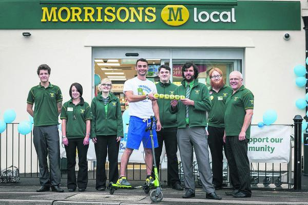 This Is Wiltshire: Morrison's M local stores are taking part in a 24-hour charity relay for their charity of the year Sue Ryder, using different forms of transport. Adrian Botwright passes the baton to Wroughton's Josh Davies, with, from left, Andy Johnson, Jenn Bethwaite
