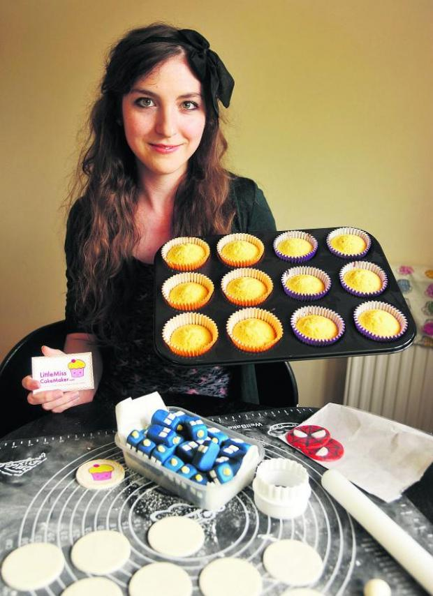 This Is Wiltshire: Samantha Whittingham with some of her cakes. Picture: Vicky Scipio