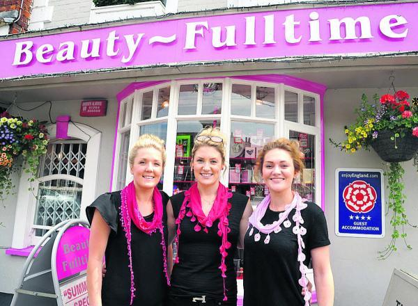 This Is Wiltshire: Megan Bowyer, centre, with her team members Elizabeth Tye, left, and Hannah Pakenham