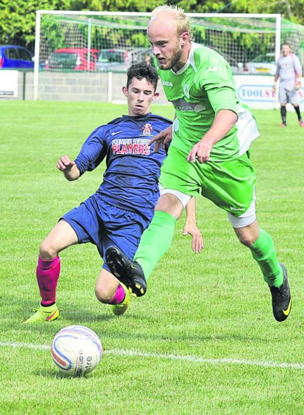 This Is Wiltshire: Westbury United new recruit Grant Gunning races past Trowbridge Town's Brett Partner during last weeken