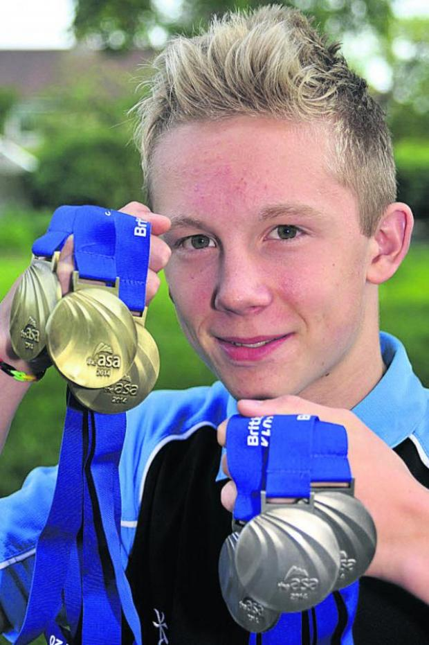 This Is Wiltshire: Jordan Ludlam shows off his haul of six national age group championship medals at home this week