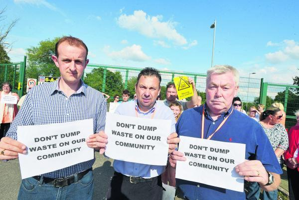This Is Wiltshire: Coun Mark Dempsey, Paul Baker and Joe Tray protesting about the waste from Averies Recycling being dumped near Penhill. Picture: Thomas Kelsey