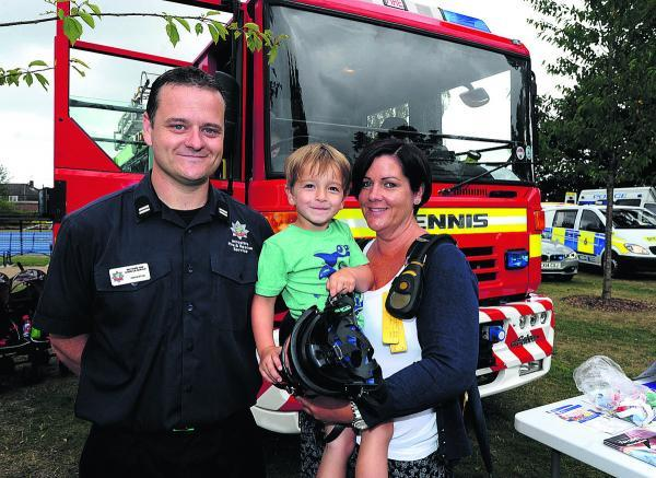 This Is Wiltshire: Louise Ruskin and William Reed meet firefighter Dan Burton at the Hillworth Park services day