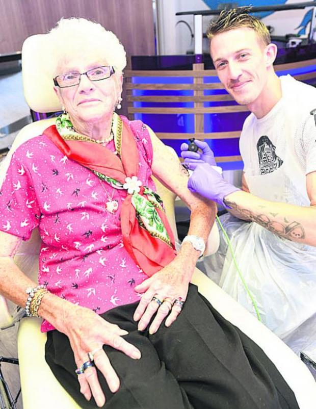 This Is Wiltshire: Grandmother Doreen Avery, 80, has a sea horse inked on her left arm by tattoo artist Tom Swift. Picture by Diane Vose