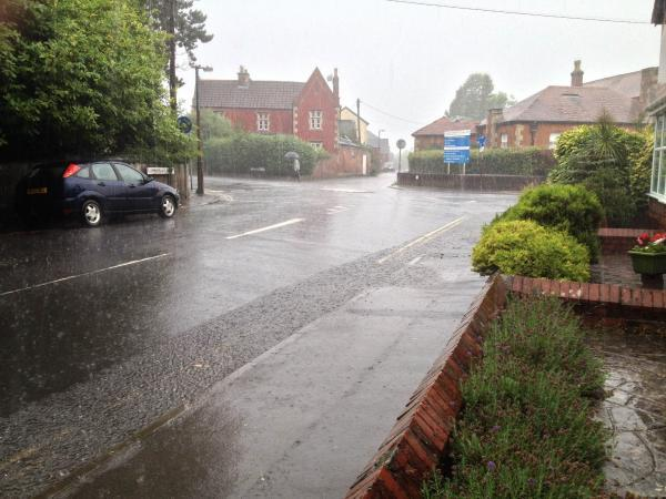 This Is Wiltshire: Drains fail to cope with the rainfall in Devizes last Saturday. More is predicted by the Met Office. Picture by Bruno Clements