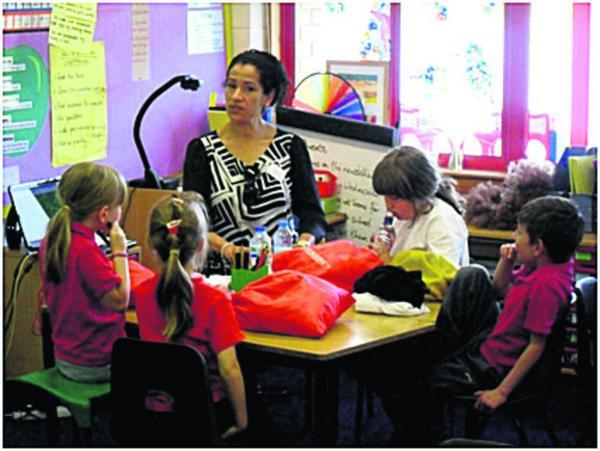 This Is Wiltshire: Salima Parmak talks to children at Walywane Court Schoo