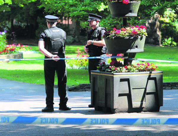 This Is Wiltshire: Police on patrol in Town Gardens after the stabbing