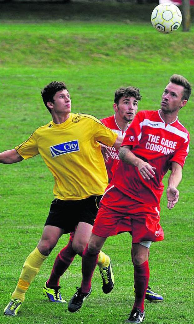 This Is Wiltshire: Action from the Red House on Saturday as Purton (red) came from behind to defeat North Leigh