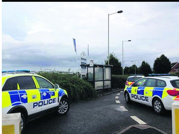 This Is Wiltshire: Police cars at the scene of the arrests near Abbey Stadium