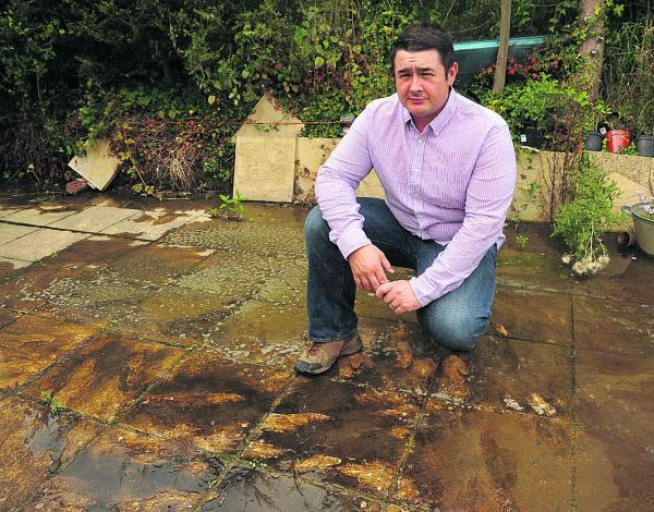 This Is Wiltshire: Carl Walker with some of the flood water at his home