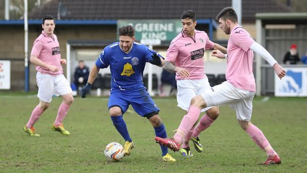 This Is Wiltshire: Luke Hopper (blue) pictured during his loan spell with Chippenham Town last season