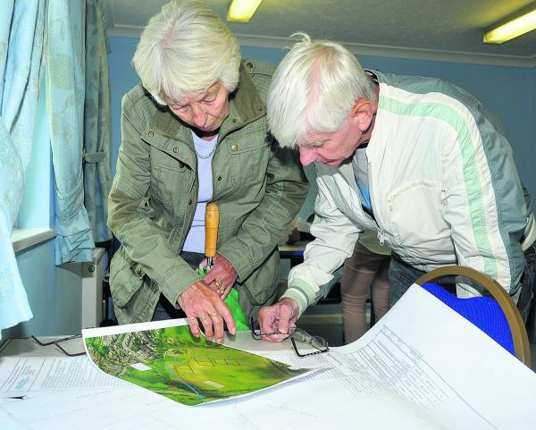 This Is Wiltshire: Visitors examine the plans at Even Community Centre