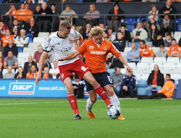 This Is Wiltshire: Two-goal Michael Smith in action at Luton