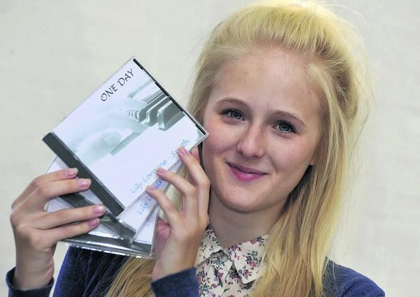 This Is Wiltshire: Lily Loraine-Smith, 15, with her new CD, which she has been selling at The Shambles                  (smb034-1)