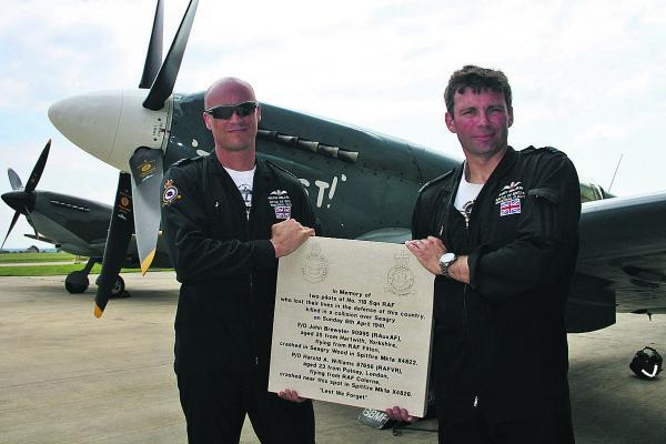 This Is Wiltshire: Members of the Battle of Britain memorial flight admire the plaque