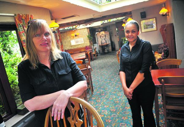 This Is Wiltshire: From left, Julie Savage, the landlady of the The Three Crowns pub, with staff member Roz Kester
