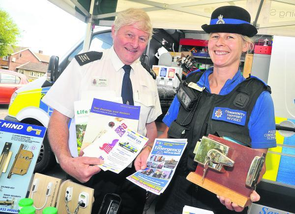This Is Wiltshire: Rod Law and Juliet Evans of Wiltshire Police taking part in the crime prevention session at the shops in Beechcroft Road
