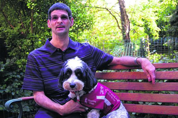 This Is Wiltshire: Thommie pictured with Tony Richards after his win in the Hearing Dog of the Year Awards