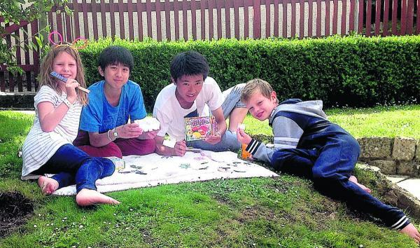 This Is Wiltshire: Naoto and Hiroki from Japan relaxing on a summer evening with Nancy and Ted Nicholls from Marlborough