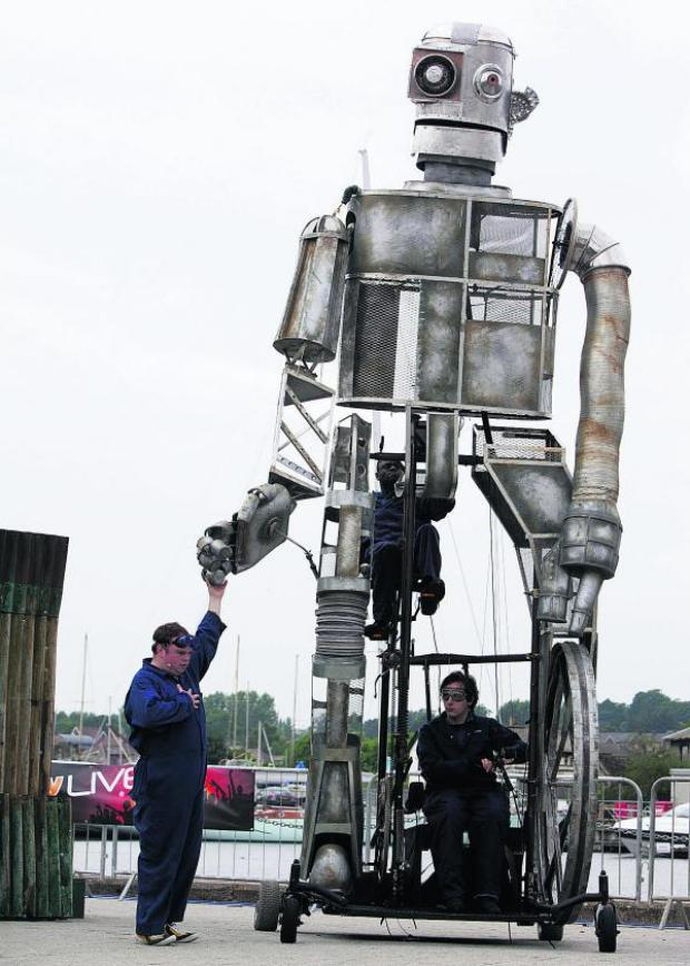This Is Wiltshire: A crew works on the imposing structure of the Iron Giant
