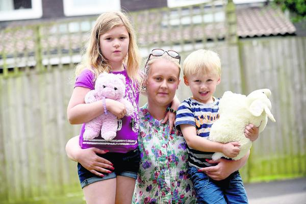 This Is Wiltshire: Katie Cross and her children Annabelle and Callum lost treasured possessions in the fire that was started by an e-cigarette