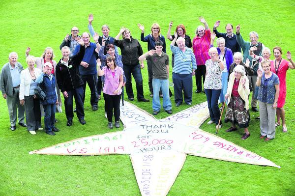 This Is Wiltshire: Volunteers gathered round the thank you star at Avebury Manor