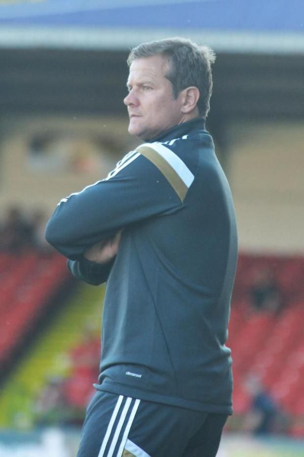 This Is Wiltshire: Mark Cooper is looking forward to pitting his Swindon Town side against Championship Brighton & Hove Albion