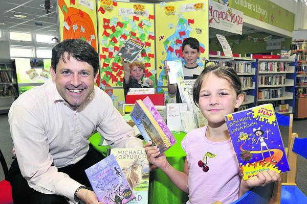 This Is Wiltshire: Chippenham MP Duncan Hames meets young readers Leah Packer, Rhys Lythell and Jonathan Andrews at Melksham library