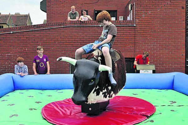 This Is Wiltshire: Alex Melville riding the bucking bull