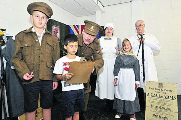 This Is Wiltshire: 'Recruiting sergeant' David Birks, 'nurse' Nikki Ritson and 'Dr' Richard Alley with 'recruits' Oliver Hoodless and Harry and Ruby Fullen in The Shires