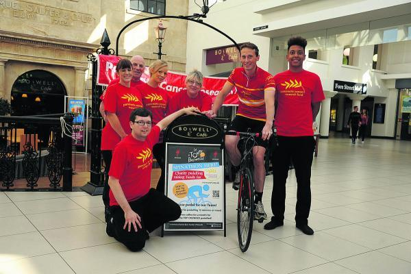 This Is Wiltshire: Boswells' Trowbridge manager Harrison Carter, with director Matt Burn on his bike, and staff launch their charity spinathon. Picture by Trevor Porter (50187)