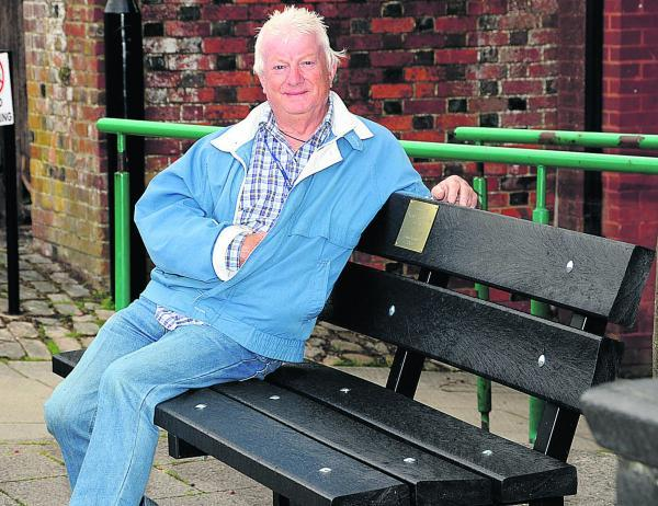 This Is Wiltshire: Mickey Dobie on the bench dedicated to his wife Heather that was commissioned to thank residents. Picture by Paul Morris